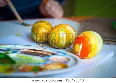 The abstract colored painted eggs