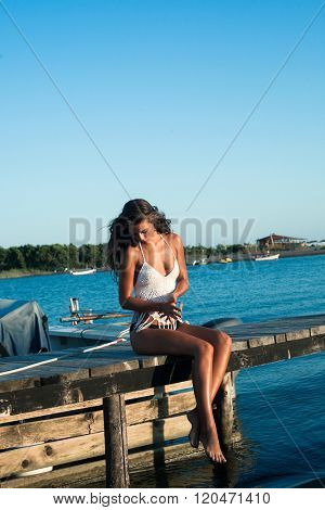 young woman enjoy in  summer sun at boat dock  at sea sunny summer day full body shot