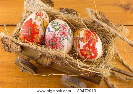 Decoupage Decorated Easter Eggs In Old Wagon