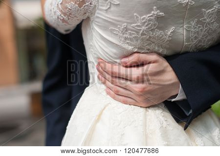 Man With Arms Around Womans Wraist