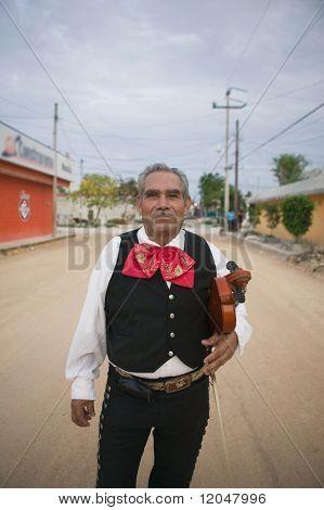 Senior Mariachi violinist holding violin