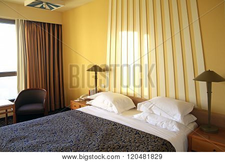 Hotel Room With Yellow Walls And  Curtains