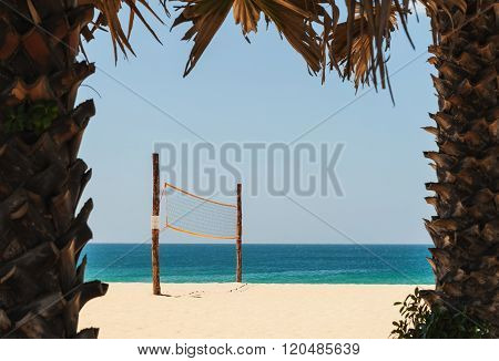 Volleyball Net On White Sand Beach And Tropical Sea