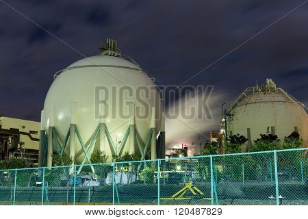 Natural Gas storage tanks at night