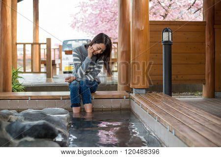 Asian Woman enjoy her foot onsen