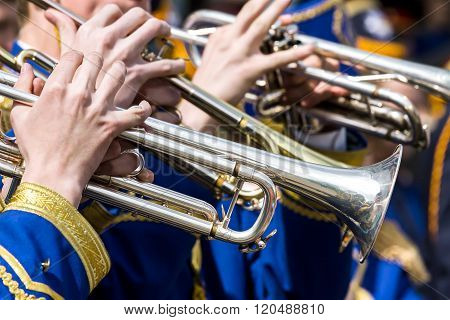 Young Musicians Plays On Trumpets On Street Concert