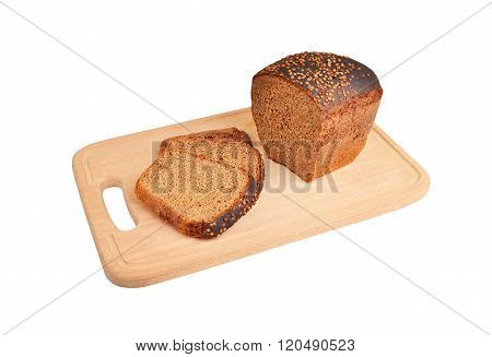 The Cut Loaf Of Bread On Wooden Board