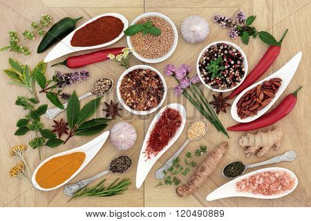 Healthy herb and spice fresh and dried food seasoning over wood background.