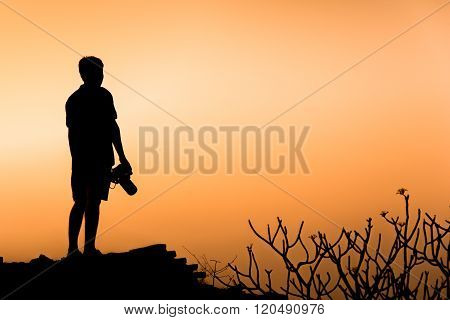 Photographer silhouette on the hill,  People silhouette concept.