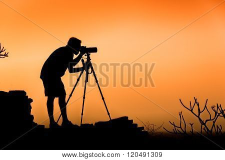 Photographer silhouette, concept of photographer and traveler