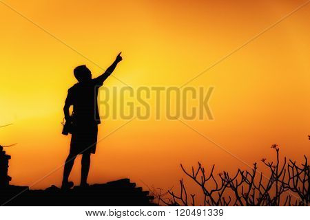 Photographer pointing sky by finger, Silhouette people, concept of future and strong people.
