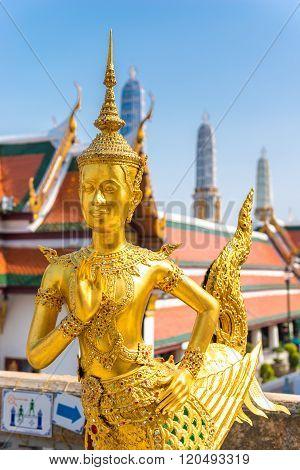 Golden Angel (Ki-nara) with Pagoda Wat Pra Kaeo, Grand Palace, Bangkok, Thailand.