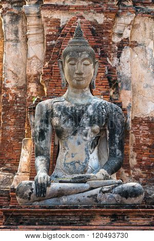 Asian religious architecture. Ancient sandstone sculpture of Buddha at Wat Mahathat temple, Ayutthaya, Thailand.