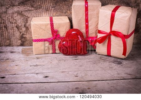 Gift Boxes  And Decorative Red  Heart On  Vintage  Wooden Background.