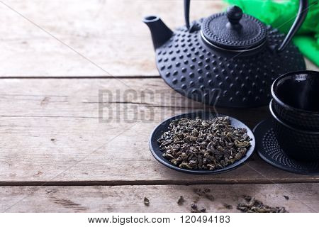 Green Tea In Bowl And Traditional Asian Tea Set  On Aged Wooden Background.
