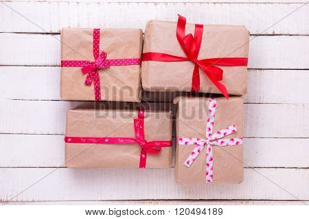 Festive Gift Boxes  On White Wooden Background.