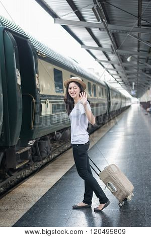 Young Asian Woman Say Goodbye To Boyfriend At Train Station Before Journey