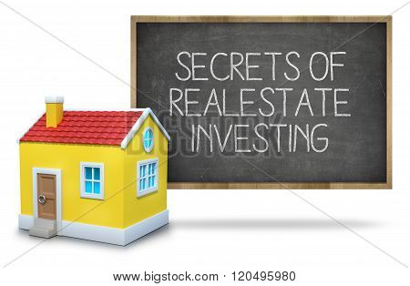 Secrets of real estate investing on blackboard