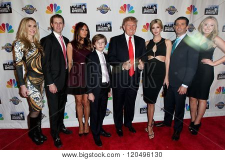 NEW YORK-FEB 16:(L-R)Lara Yunaska, Eric Trump, Melania Trump, Barron Trump, Donald Trump, Ivanka Trump, Donald Trump Jr. & Tiffany Trump at 'Celebrity Apprentice' on February 16, 2015 in New York.
