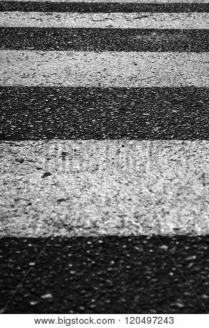Vertical full frame zebra crossing on asphalt road.