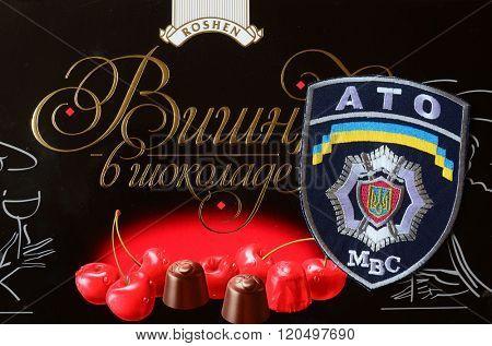 Kiev,Ukraine.FEB 20 ILLUSTRATIVE EDITORIAL.Chevron of Ukrainian Army. With logo Roshen Inc. Trademark Roshen is property of Ukrainian president Poroshenko.At February 20,2016 in Kiev, Ukraine