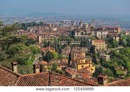 View at Old Town Citta Alta of Bergamo from San Vigilio Hill. Bergamo, Italy