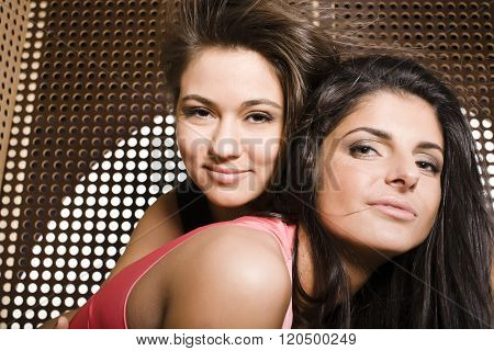 two pretty girlfriends at party dancing smiling close up, fancy fashion dresses