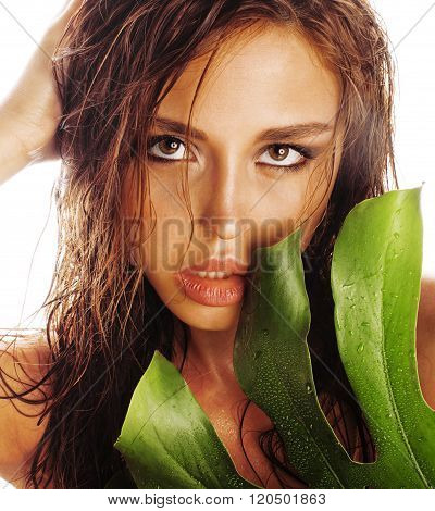 young brunette elegant woman with green leaf isolated on white close up asian face
