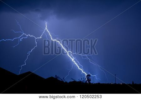 Cloud to Ground forked Lightning Strike in the night sky