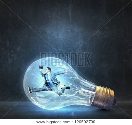 Man inside of electric bulb