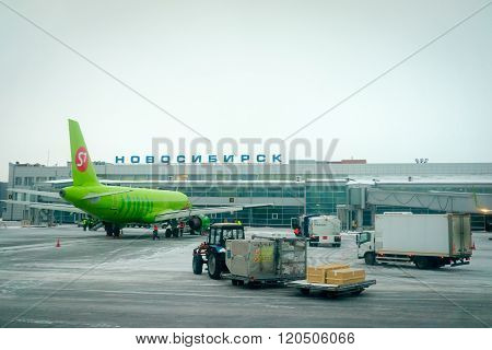 Novosibirsk, Russia - March 02, 2016: Airplane Of S7 Airlines Preparing For Flight In Tolmachevo Air