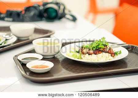 Thai Food Rice With Pork Chinese Style At Airport Lounge In Bangkok - Asian Fast Food Dish On Table