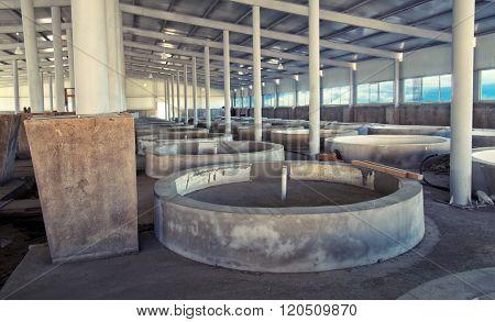 fish farm interior with empty fish tanks