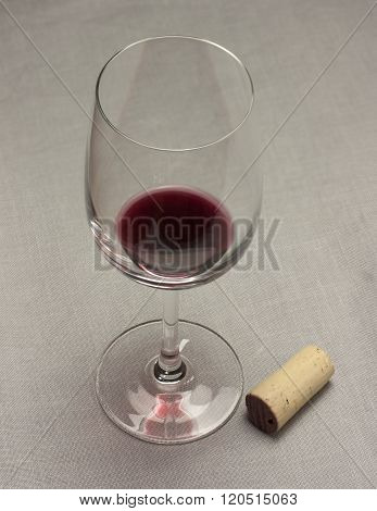 Glass With Little Bit Of Red Wine Poured For Tasting