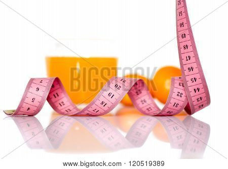 fruits and measuring tape on a white background to symbolize a healthy diet