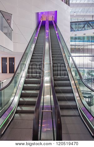 Escalator With Purple Illumination In Modern Office Building