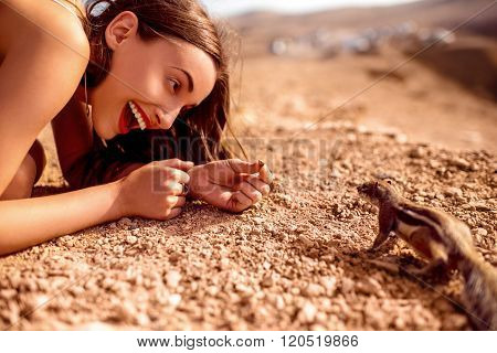 Woman feeding moorish squirrel
