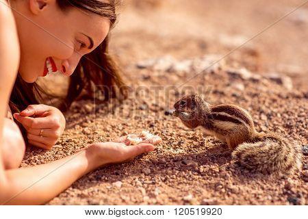 Woman feeding moorish squirrel