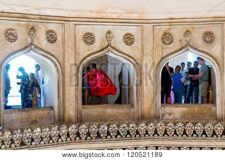 People looking through arches at charminar hyderabad