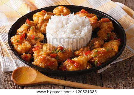 Delicious Orange Chicken With Rice Garnish Close Up. Horizontal