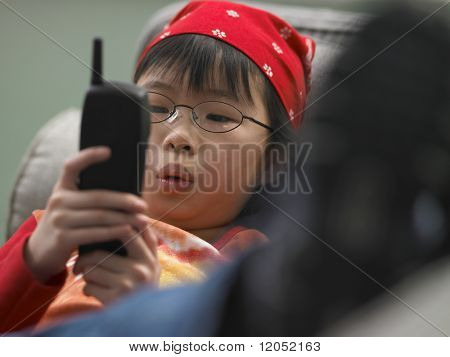 Close up of young girl dialing phone
