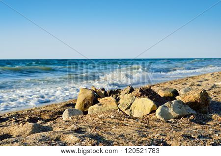 Boulders On The Beach, Against Tidal Bore Of The Sea