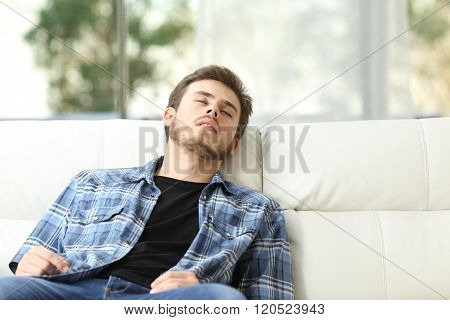 Tired Man Sleeping On A Couch