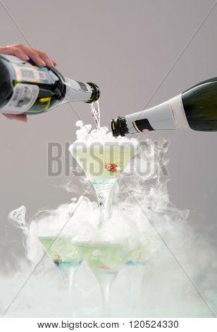 Spilling champagne in festive glasses.