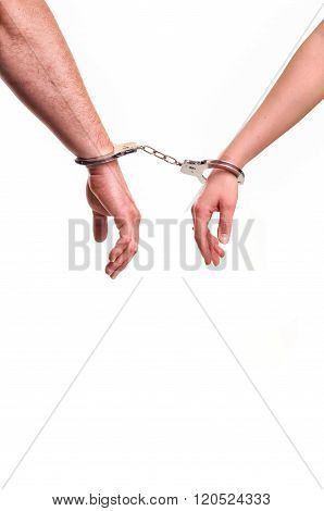 Man And Woman's Hands Handcuffed Together Concept Of Love, Relationship, Romance, Sex, Crime, Punish