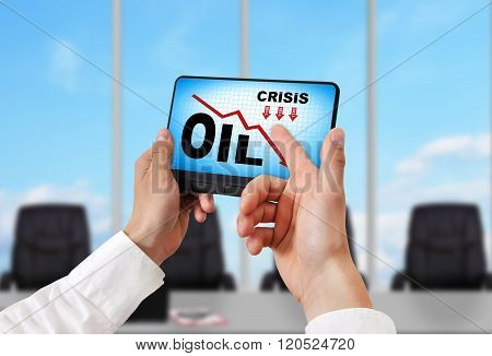 Tablet With Oil Crisis Chart