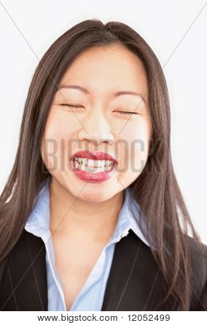 Close up of businesswoman with eyes closed