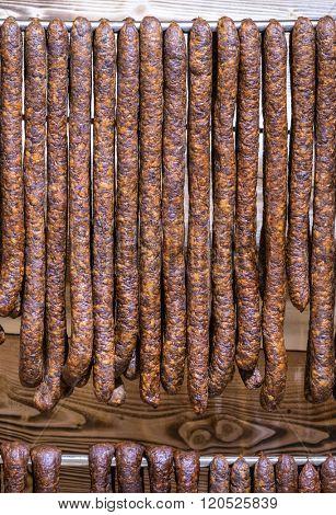 Handmade sausages at display at the foodmarket