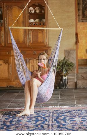 Young woman sitting on swing