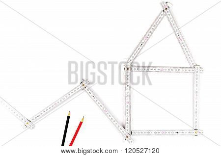 White Meter Tool Forming A House, Two Drawing Pencils On White  Background